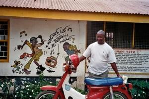 de leraar william in een centrum voor straat kinderen